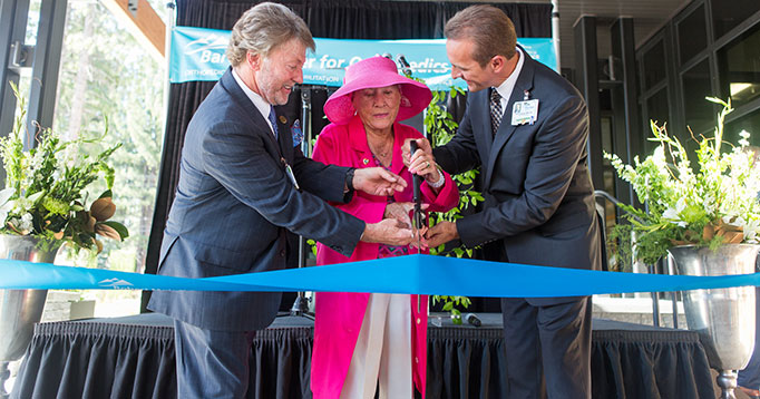 Ribbon Cutting: Marking a new era for health care in the region, Barton Health Chairman of the Board, Kirk Ledbetter, donor and philanthropist, Lisa Maloff and Barton Health President & CEO, Dr. Clint Purvance cut the ribbon at the Robert Maloff Center gra