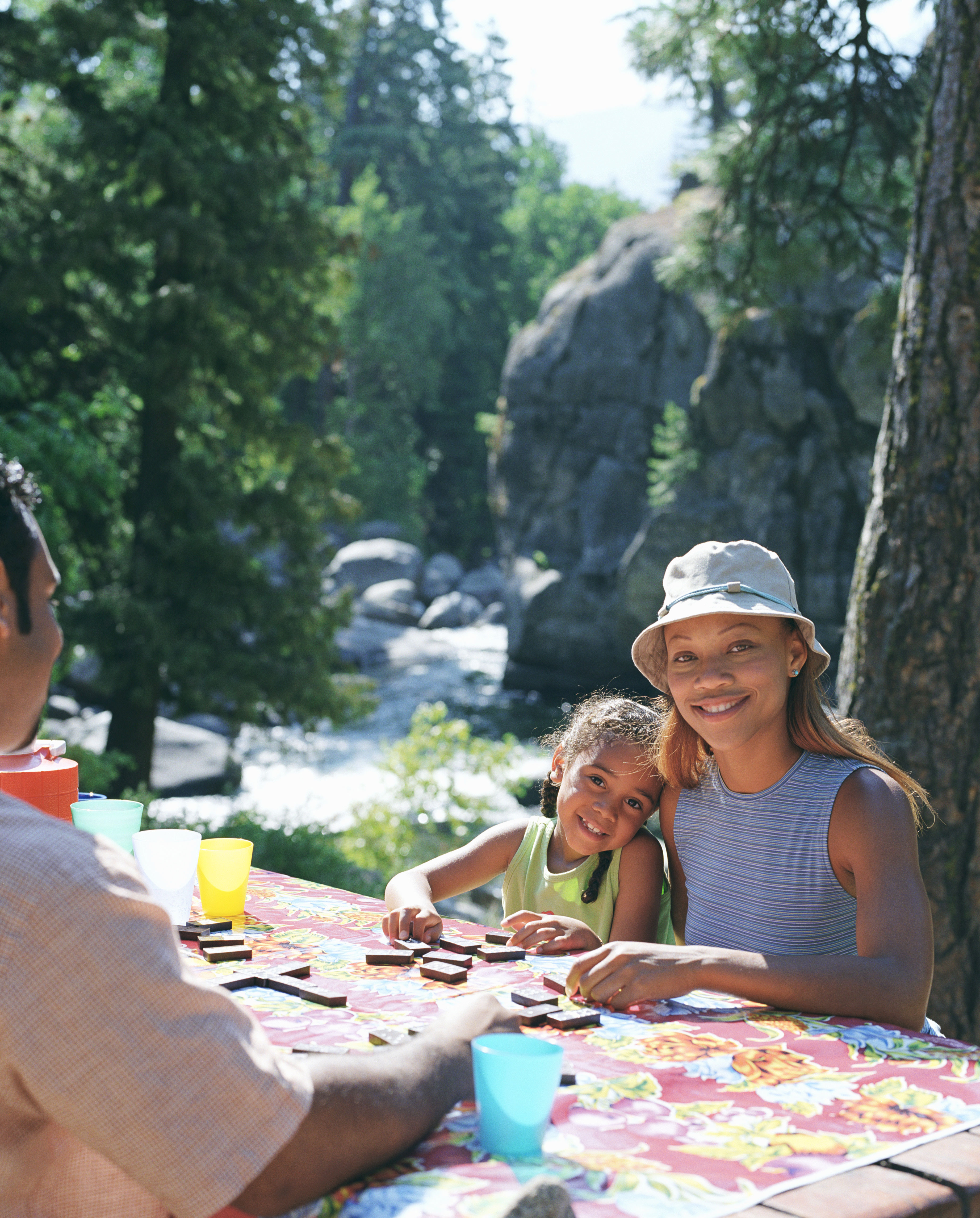 Summer Fun - A family plays board games outside in the mountains.